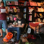 John Hartigan reading while Eben Kirksey prepares nuts.